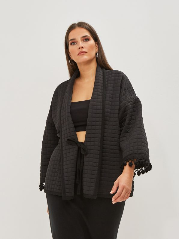 Quilted jacket with tassel-detailed sleeves