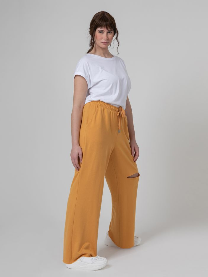 Ripped knee flare trousers